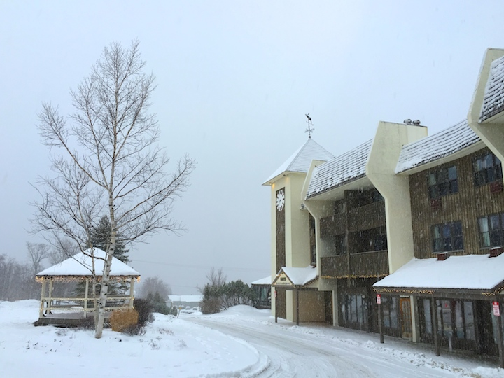 The inn at Bolton valley covered in snow