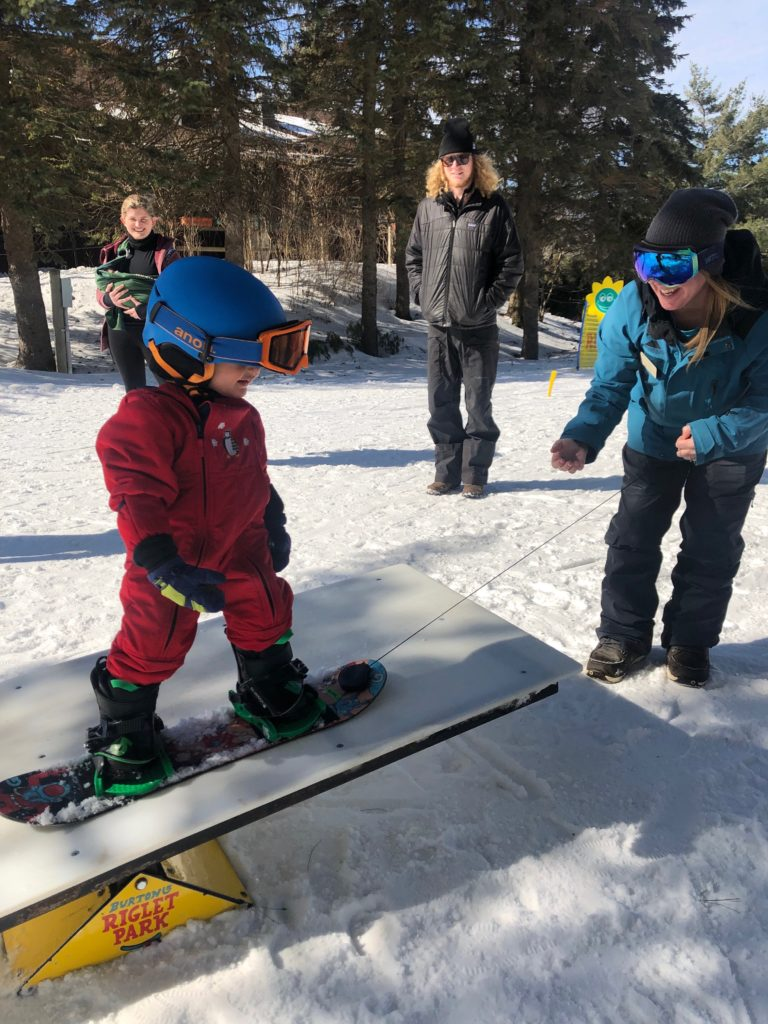 Mommy and Me toddler snowboards lessons at Smuggs